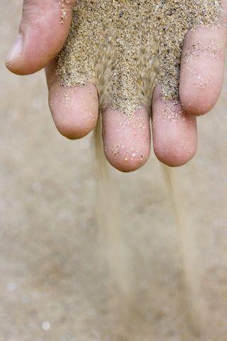 Bigstock-sand-in-hand-15193313